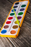 Water Color Paints on Vintage Wood Royalty Free Stock Photos