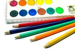 Water color palette and color pencils Royalty Free Stock Image