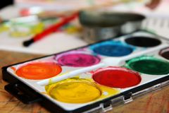 Water color set for children on the table stock image
