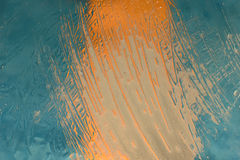 Water colored drops painting. Water texture painting on illuminated glass Royalty Free Stock Image