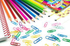 Water colored pencils and paperclips, school concept Royalty Free Stock Photography
