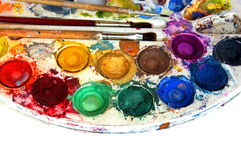 Water-colorpaint-box und -lackpinsel Stockfotos