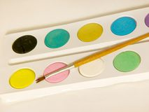Water colors. Watercolor paint and brush royalty free stock photos