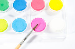 Water colors with brush Royalty Free Stock Photography