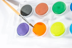 Water colors with brush Stock Images