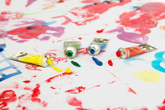 Water colors and brush on painted paper. Royalty Free Stock Photography
