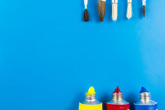 Water color and paint brush. Water colors and paint brushes on blue background Royalty Free Stock Photography