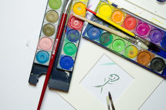 Water colors with painting an brushes Stock Image
