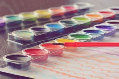 Water Colors. Selective focus on a set of watercolors paints Royalty Free Stock Image