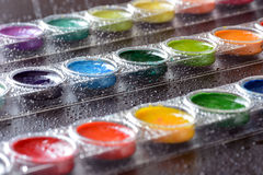 Water Colors. Selective focus on a set of watercolors paints Royalty Free Stock Photography