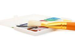 Water colour paints and brush Royalty Free Stock Photos