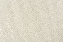 Water-colour paper texture background in light beige tone. stock image