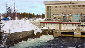 Water comes out of a hydroelectric turbine. North of Russia stock footage