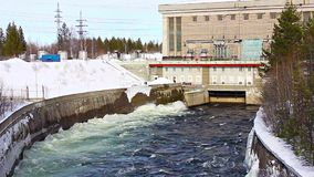 Water comes out of a small hydroelectric turbine stock video