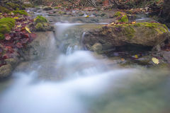 Water coming down. Little waterfall in Crimea mountains in autumn Stock Images