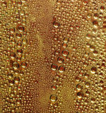 Water Condensation on Yellow Surface Royalty Free Stock Images