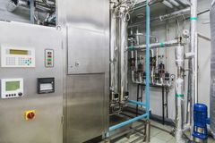 Water conditioning or distillation room. And control panel equipment on pharmaceutical industry or chemical plant Royalty Free Stock Photo