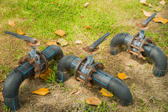 Water control valve on field grass, HDPE pipeline. Royalty Free Stock Image