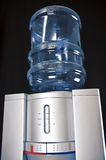 Water Cooler. On a dark background Royalty Free Stock Photos