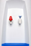 Water cooler. Hot and cold faucet of water cooler Stock Images