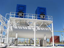 Water cooling tower. Equipment for primary oil refining Stock Photos