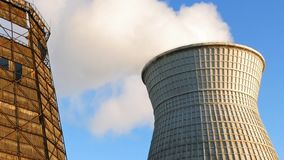 Water cooling tower stack smoke over blue sky. Background. Energy generation and air environment pollution industrial scene stock video