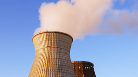 Water cooling tower stack smoke over blue sky. Background. Energy generation and air environment pollution industrial scene Stock Photos