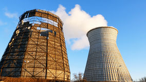 Water cooling tower stack smoke over blue sky. Background. Energy generation and air environment pollution industrial scene Royalty Free Stock Photography