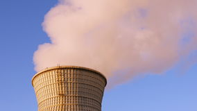 Water cooling tower stack smoke over blue sky. Background. Energy generation and air environment pollution industrial scene. 4K UHD video footage stock video