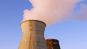 Water cooling tower stack smoke over blue sky. Background. Energy generation and air environment pollution industrial scene. 4K UHD video footage stock video footage