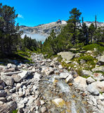 Water course flowing to Aubert lake in Neouvielle Mountain Massi Stock Photo