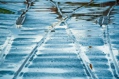 Water covered railway tracks Stock Images