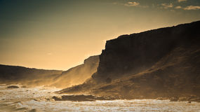 Water Crashing by a Cliff Wall Royalty Free Stock Photos