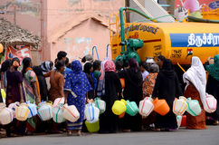 WATER CRISSIS. Womens collecting drinking water from  the truck at tamilnadu,they were waiting to collect the water. photo taken on;april 2nd 2015 Royalty Free Stock Photos