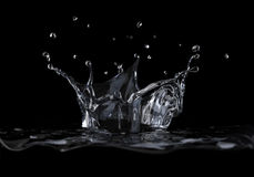 Water crown splash viewed from a side, on black background. Royalty Free Stock Image