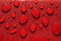 Water-dalingen op rood Royalty-vrije Stock Foto