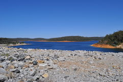 Water dam embankment and reservoir Royalty Free Stock Images