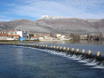 Water dam and Hills. Water dam in town of Trebinje, Bosnia and Hercegovina with mountains in background Royalty Free Stock Image