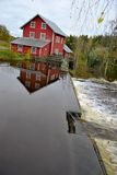 Water dam and red house mill Stock Photo