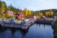 Water dam and red houses Royalty Free Stock Images