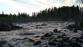 Water dam and reservoir lake 4k  footage in Swedish mountains generating hydroelectricity power renewable energy
