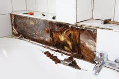 Water damage around the bathtub stock photos