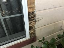Water Damaged Wood Siding Around Window Royalty Free Stock Images