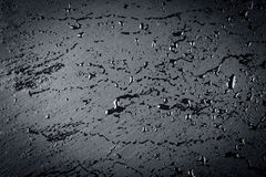 Water on dark stone surface Royalty Free Stock Image