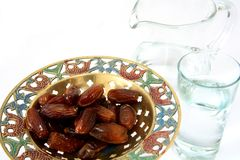 Water and dates Royalty Free Stock Photos