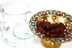 Water and dates for iftar stock image