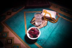 Water and dates. Iftar is the evening meal. View of decoration Ramadan Kareem holiday on carpet. Festive greeting card, invitation. For Muslim holy month stock photography