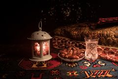 Water and dates. Iftar is the evening meal. View of decoration Ramadan Kareem holiday on carpet. Festive greeting card, invitation. For Muslim holy month stock image