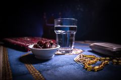 Water and dates. Iftar is the evening meal. View of decoration Ramadan Kareem holiday on carpet. Festive greeting card, invitation. For Muslim holy month royalty free stock images