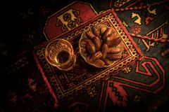 Water and dates. Iftar is the evening meal. View of decoration Ramadan Kareem holiday on carpet. Festive greeting card, invitation. For Muslim holy month royalty free stock photos
